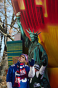 NEW YORK, NY, USA, Nov. 28, 2013. A float celebrating the Big Apple carries sports stars Amani Toomer, Bart Oates, Hines Ward, and Joe Namath during the 87th Annual Macy's Thanksgiving Day Parade.