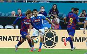 FC Barcelona forward Antoine Griezmann (17) dribbles away from SSC Napoli Kostas Manolas (44) during a La Liga-Serie A Cup soccer match, Wednesday, Aug. 7, 2019, in Miami Gardens, Fla. FC Barcelona beat Napoli 2-1 (Kim Hukari/Image of Sport)