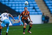 Bradford City defender Anthony McMahon (29) with his eye on the ball during the EFL Sky Bet League 1 match between Coventry City and Bradford City at the Ricoh Arena, Coventry, England on 11 March 2017. Photo by Simon Davies.