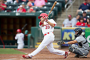 Jake Lemmerman (23) of the Springfield Cardinals follows through his swing after making contact on a pitch during a game against the Northwest Arkansas Naturals at Hammons Field on July 28, 2013 in Springfield, Missouri. (David Welker)