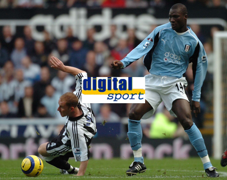 Credit: Back Page Images / Matthew Impey. Newcastle United v Fulham, FA Premiership, 7/11/2004. Bouba Papa Diop (Fulham) Nicky Butt (Newcastle)