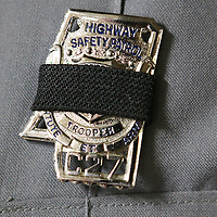 Officers from around Northeast Mississippi wore a black ribbon over their badges during Thursday's funeral for Mississippi Highway Patrol officer Cpl. Josh Smith in Corinth.