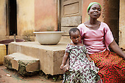 Christine Koné, 26, sits at home with her daughter Ruth Dablé, 2, in the town of Katiola, Cote d'Ivoire on Friday July 12, 2013. Christine underwent FGM as a child and now suffers from incontinence. She says she would never allow her daughter to undergo the procedure.