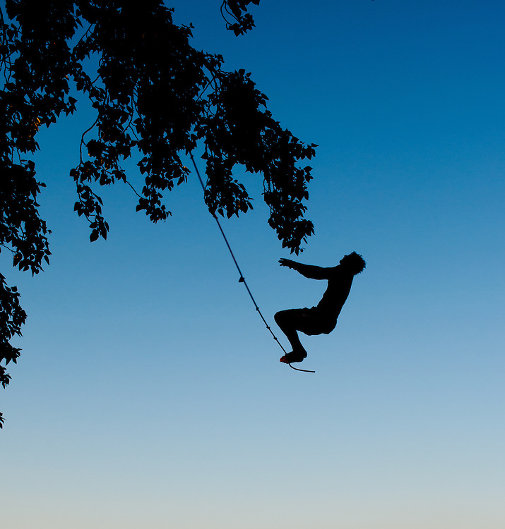 My friend Nick about to jump off a rope swing from a tree in Magnuson Park in Seattle, Washington.