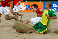 07 December 2006, Brazil's Sidney Souto and England's Kieran O'Callahan fight for the ball during the first game of the Vodacom Pro Beach Soccer Tour in Durban's Bay of Plenty on Thursday. Brazil won the game 10 - 3. Picture: Shayne Robinson, PhotoWire Africa