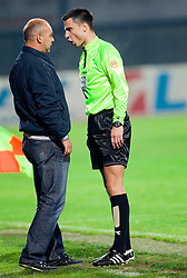 Head coach of Domzale Darko Birjukov talks to referee Slavko Vincic  during the football match between NK Domzale and MIK CM Celje, played in the 10th Round of Prva liga football league 2010 - 2011, on September 22, 2010, Spors park, Domzale, Slovenia. Domzale defeated Celje 1 - 0. (Photo by Vid Ponikvar / Sportida)
