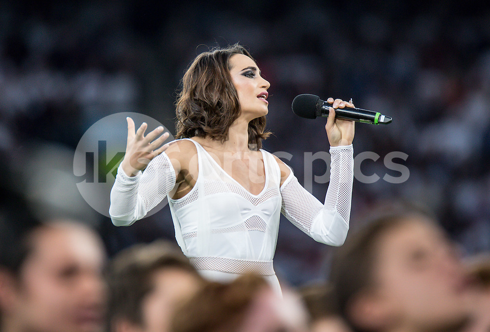 Soprano Laura Wright sings at the opening ceremony during the Rugby World Cup 2015 Pool A match between England and Fiji played at Twickenham Stadium, London on 18 September 2015. Photo by Liam McAvoy.