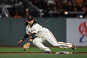San Francisco Giants shortstop Brandon Crawford (35) dives for a wide throw at second base against the Los Angeles Dodgers at AT&T Park in San Francisco, California, on April 24, 2017. (Stan Olszewski/Special to S.F. Examiner)