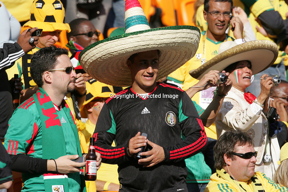Fans celebrate during the World Cup Opening Ceremony held at Soccer City in SOWETO, Johannesburg, South Africa on the 11th June 2010<br /> <br /> Photo by Ron Gaunt/SPORTZPICS