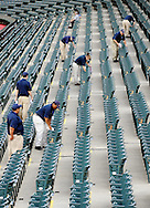 CLEVELAND, OH USA - JULY 6: Workers clean seats before the game between the Cleveland Indians and the New York Yankees at Progressive Field in Cleveland, OH, USA on Wednesday, July 6, 2011.