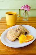 Two Loons Cafe, a sandwich shop located in Old Town Bandon, Oregon. Cranberry scones with lemon curd and hot coffee.