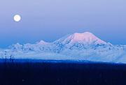 Alaska. Talkeetna. Full moon over Mt Foraker (17,400 ft)in Denali NP.