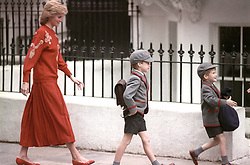 The Princess of wales follows her sons Prince Harry (right), five years old, and Prince William, seven, on Harry's first day at the Wetherby School in Notting Hill, West London.