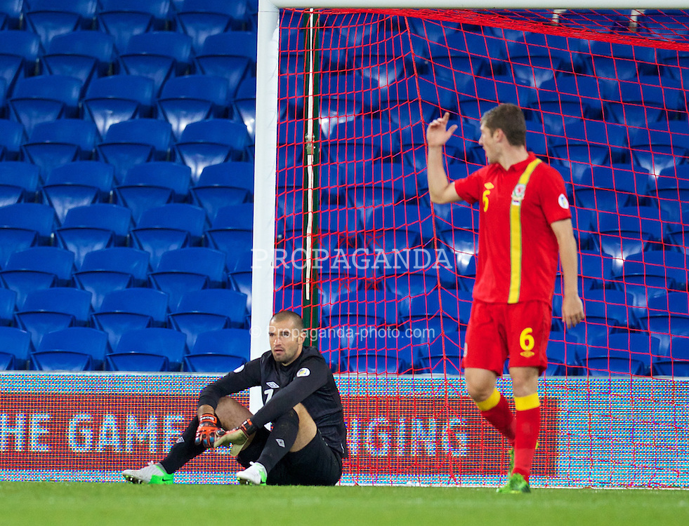 CARDIFF, WALES - Tuesday, September 10, 2013: Wales' goalkeeper Boaz Myhill looks dejected after Serbia score the third goal during the 2014 FIFA World Cup Brazil Qualifying Group A match at the Cardiff CIty Stadium. (Pic by David Rawcliffe/Propaganda)