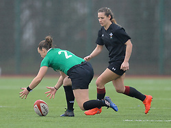 Ireland women's Chodhna Moloney and Wales women's Kerin Lake contest the ball<br />  <br /> Photographer Mike Jones/Replay Images<br /> <br /> International Friendly - Wales women v Ireland women - Sunday 21st January 2018 - CCB Centre for Sporting Excellence - Ystrad Mynach<br /> <br /> World Copyright © Replay Images . All rights reserved. info@replayimages.co.uk - http://replayimages.co.uk