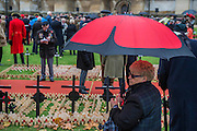Poppy umbrellas protect from the brief rain - The Duke of Edinburgh, Life Member, Royal British Legion, accompanied by Prince Harry, visit the Field of Remembrance at Westminster Abbey  - 10 November 2016, London.