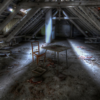 Old unused Soviet sports hospital in East Germany with broken chair and small table