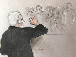 Court artist sketch by Elizabeth Cook of Julian Assange saluting his supporters as he appears before Southwark Crown Court in London for breaching his bail.