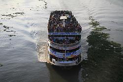 June 23, 2017 - Dhaka, Bangladesh - Bangladeshi travelers ride on an over crowed ferry as they go home to celebrate Eid-al-Fitr festival in Dhaka, Bangladesh on June 23, 2017. Muslims around the world will celebrate Eid-al-Fitr festival after end of the holy month of Ramadan. (Credit Image: © Rehman Asad/NurPhoto via ZUMA Press)