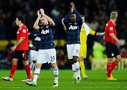 Man Utd Midfielder Tom Cleverley (ENG) and Forward Danny Welbeck (ENG) applaud the away support after a 2-2 draw in the match - Photo mandatory by-line: Rogan Thomson/JMP - Tel: Mobile: 07966 386802 - 24/11/2013 - SPORT - FOOTBALL - Cardiff City Stadium - Cardiff City v Manchester United - Barclays Premier League.