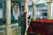 Celebrated young pakistani artist Asim Butt on a journey of political graffiti through Pakistan during the summer of 2009..At the Bhutto family mausoleam in Garhi Khuda Buxbhutto near lakana town Asimpays his respects to benazir Bhutto.