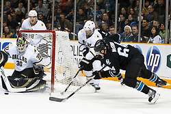 December 13, 2010; San Jose, CA, USA;  Dallas Stars goalie Andrew Raycroft (30) saves a shot from San Jose Sharks left wing Jamie McGinn (64) during the first period at HP Pavilion. Mandatory Credit: Jason O. Watson / US PRESSWIRE