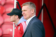 Brentford Head Coach Dean Smith pulling a face during the Sky Bet Championship match between Brentford and Fulham at Griffin Park, London, England on 30 April 2016. Photo by Matthew Redman.