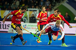 England's Ashley Jackson is tackled by Bosco Perez Pla and Pau Quemada of Spain. England v Spain - Unibet EuroHockey Championships, Lee Valley Hockey & Tennis Centre, London, UK on 25 August 2015. Photo: Simon Parker