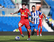 Blackburn Rovers player Danny Guthrie shields the ball from Brighton central midfielder Beram Kayal during the Sky Bet Championship match between Brighton and Hove Albion and Blackburn Rovers at the American Express Community Stadium, Brighton and Hove, England on 22 August 2015. Photo by Bennett Dean.