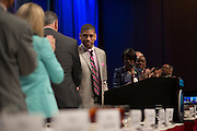 Sacramento Mayor and President of the United States Conference of Mayors, Kevin Johnson, shakes hands with Dallas Mayor Mike Rawlings during the Opening Plenary Luncheon to begin 82nd annual meeting at the Omni Hotel in Dallas, Texas on June 20, 2014.  (Cooper Neill for The New York Times)