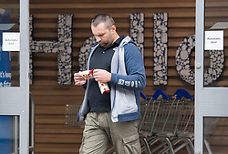 © Licensed to London News Pictures. 24/07/2020. London, UK. A shopper leaves Tesco on Goodge Street in central London not wearing a face mask, on the day that the wearing of mask in shops becomes compulsory. The UK Government has published formal guidance on spaces where the wearing of masks will now be mandatory, including in shops, supermarkets and shopping centres. Photo credit: Ben Cawthra/LNP