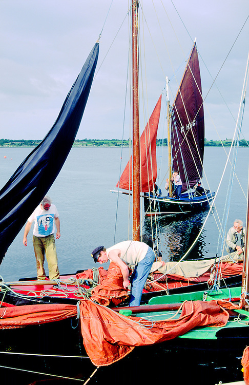 County Galway, Ireland. Traditional red sails fishing boats known as a Galway Bay hooker. Annual sailing festival at Kinvara.