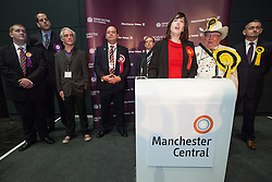 © Licensed to London News Pictures . 16/11/2012 . Manchester , UK . Labour's Lucy Powell gives her victory speech . Behind, l-r: Christopher Cassidy (UKIP), Lee Holmes (People's Democratic Party), Loz Kaye (Pirate Party), Eddy O'Sullivan (BNP), Matthew Sephton (Conservative), Howling Laud Hope (Monster Raving Loony William Hill Party) & Marc Ramsbottom (Liberal Democrats). Manchester Central by election result at Manchester Central Convention Centre . Photo credit : Joel Goodman/LNP