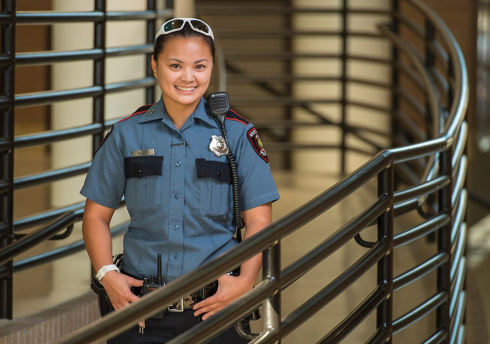 """Houston ISD police officer Minhnguyet """"Nicky"""" Tran poses for a photograph at Chavez High School, October 24, 2014."""