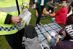 Hyde Park, London, 20/04/2014<br /> Police confiscate spliffs during a pro-cannabis rally organised by group 420, in Hyde Park, central London. <br /> Photo: Anna Branthwaite/LNP