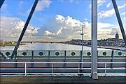 Nederland, Nijmegen, 4-2-2015Panorama van de skyline van Nijmegen, stad aan de rivier de waal, rijn, vanaf de spoorbrug. Links de verkeersbrug, waalbrug, rechts de st. stevenskerk waarvan de toren, stevenstoren, kerktoren in de steiger staat vanwege groot onderhoud. Zicht op de waalkade.