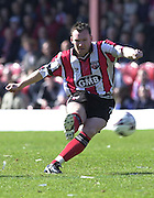 .Photo Peter Spurrier.06/04/2002.Nationwide Div 2.Brentford vs Huddersfield - Griffen Park:.Paul Evan's with a shot on goal..