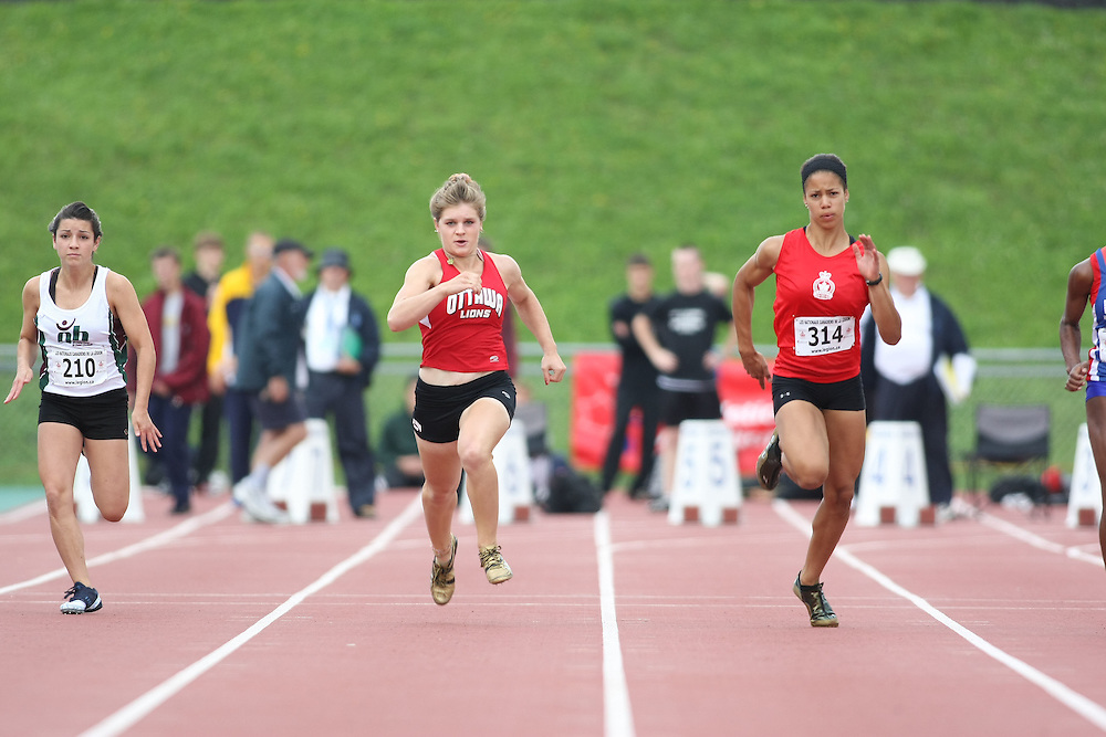 (Sherbrooke, Quebec---10 August 2008) Julia Cormier and (210) Ashley Wilson (center) Ashley Maddex (right)\ competing in the youth girls 100m heats at the 2008 Canadian National Youth and Royal Canadian Legion Track and Field Championships in Sherbrooke, Quebec. The photograph is copyright Sean Burges/Mundo Sport Images, 2008. More information can be found at www.msievents.com.
