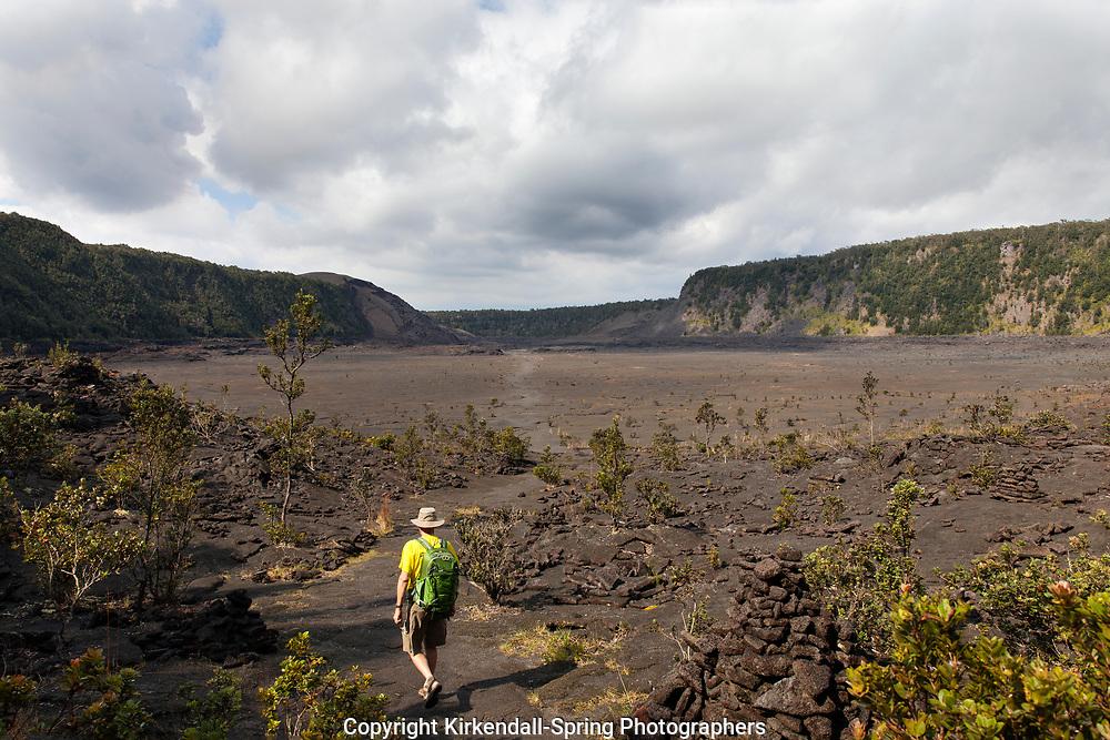 HI00371-00...HAWAI'I - Hiker crossing the Kilauea Iki Crater in Hawai'i Volcanoes National Park. (MR# V2)