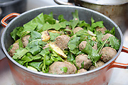 Cooking meatballs - Meatballs cook in a pot