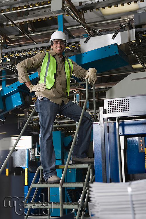 Man working in factory on steps