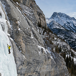 Pat Lindsay leading one of the upper pitches of A Bridge Too Far, WI4+ 300m, Kananaskis, Alberta, Canada