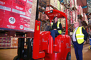 l-r, Fork lift driver at the Tayto Warehouse, Scott Monaghan ,chats with, Phil Storer, Country director Pooling Partners