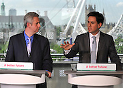 © licensed to London News Pictures. LONDON, UK.  11/07/11. Ed Miliband (R) and Ivan Lewis (L) at the conference. Ed Miliband gives his monthly press conference at The Royal Festival Hall. He was joined by Ivan Lewis the Shadow Culture Secretary to take questions on the News of The World story. Mandatory Credit Stephen Simpson/LNP