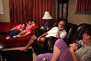 Kara, left, watches Survivor with her parents Cheryl, second from left, and Rick Marler with her sister Kayla, right, in the living room. Kara said her family has always been close but after Kayla's accident the bond grew even tighter.
