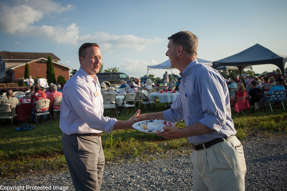 Prince William County Supervisor, Corey Stewart chats with fellow Republican Gubernatorial candidate, Rep. Rob Wittman (VA-1) during an appearance at the Page County , VA GOP Jamboree, in Luray, VA on Saturday, June 25, 2016.  Stewart recently ran the Trump operation in Virginia. Both Stewart and Wittman made brief remarks to the attendees.  John Boal Photography