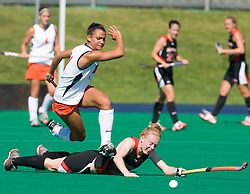 Virginia Cavaliers midfielder Paige Selenski (21) hurdles Maryland Terrapins Back Emma Thomas (7).  The #1 ranked Maryland Terrapins defeated the #10 ranked Virginia Cavaliers 4-3 in overtime in NCAA Field Hockey at the Turf Field on the Grounds of the University of Virginia in Charlottesville, VA on October 4, 2008.