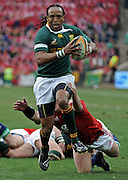 Odwa Ndungane of the Springboks on the charge with Matthew Rees of the Lions trying to stop him.<br /> Rugby - 090704 - Springboks vs British&Irish Lions - Coca-Cola Park - Johannesburg - South Africa. The Lions won 28-9 but lost the series 2-1 to the Springboks.<br /> Photographer : Anton de Villiers / SASPA