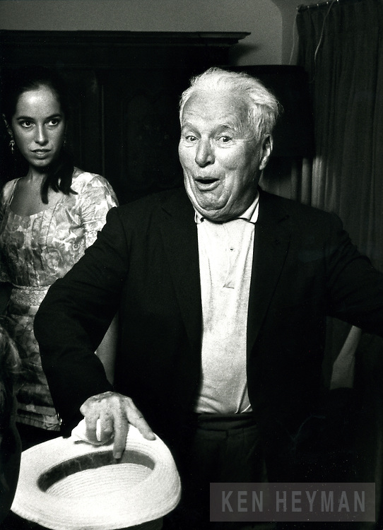 Comedian Charlie Chaplin, 1967 with daughter behind.