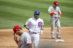 August 17, 2017 - Chicago, IL, USA - The Chicago Cubs' Alex Avila, middle, runs the bases after hitting a home run during the fourth inning against the Cincinnati Reds at Wrigley Field in Chicago on Thursday, Aug. 17, 2017. The Reds won, 13-10. (Credit Image: © Armando L. Sanchez/TNS via ZUMA Wire)